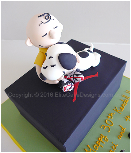Kids birthday cake of Charlie Brown and Snoopy on a Michael Jordan Nike shoe box