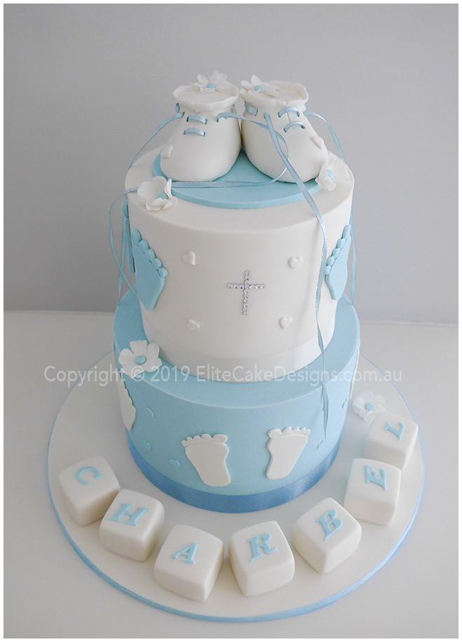 Baby booties 2 tier Christening Cake with blocks