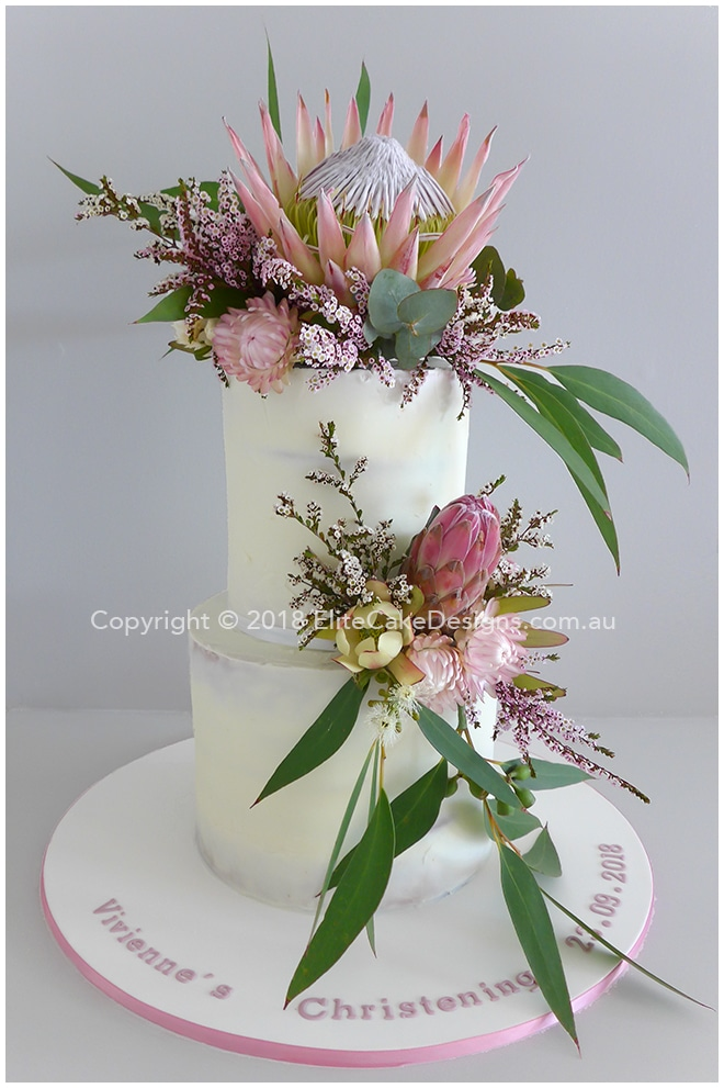 Semi Naked Girls Christening cake with native flowers