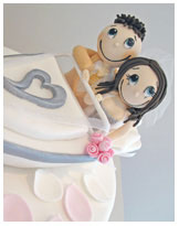 funky couple in boat wedding cake