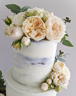 Semi-naked rustic wedding cake with David Austin roses