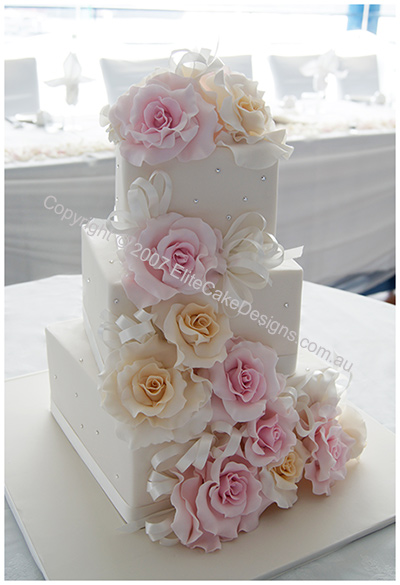 Wedding Cake with ivory and pink roses and swarovski crystals